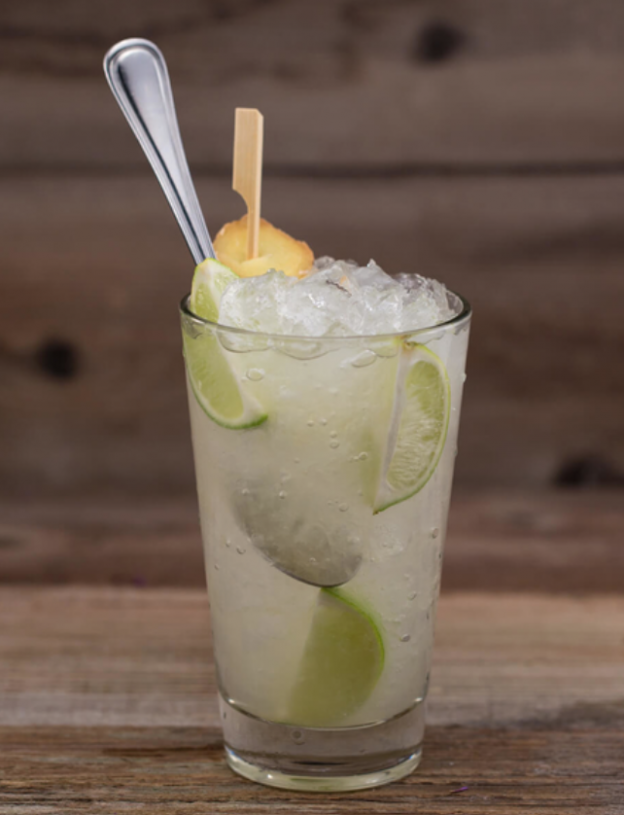 A Fresh Citrus Cocktail with Lime and Orange wedges